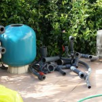 Bead filter being replaced by ERIC Three units on koi pond in Spain