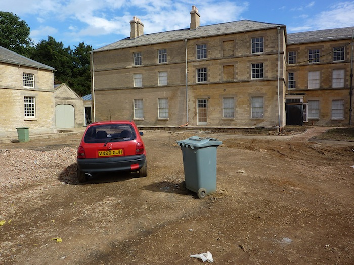 Car in courtyard to show location of pond - dustbin shows location of centre of pond
