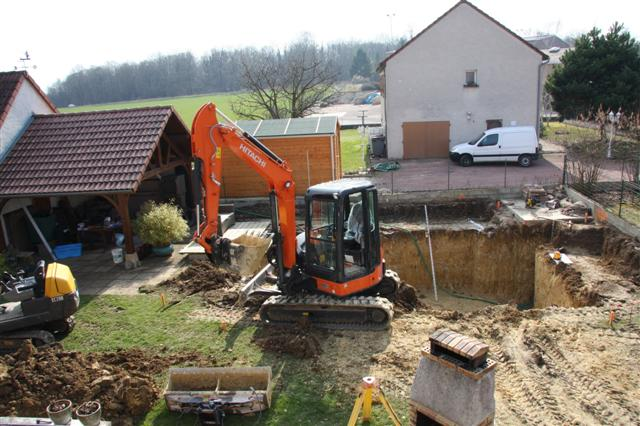 Digger removing soil