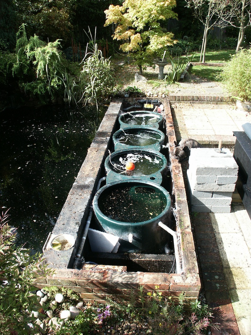 Eric koi pond filtration surrey koi pond conversion for Bottom drain pond filter