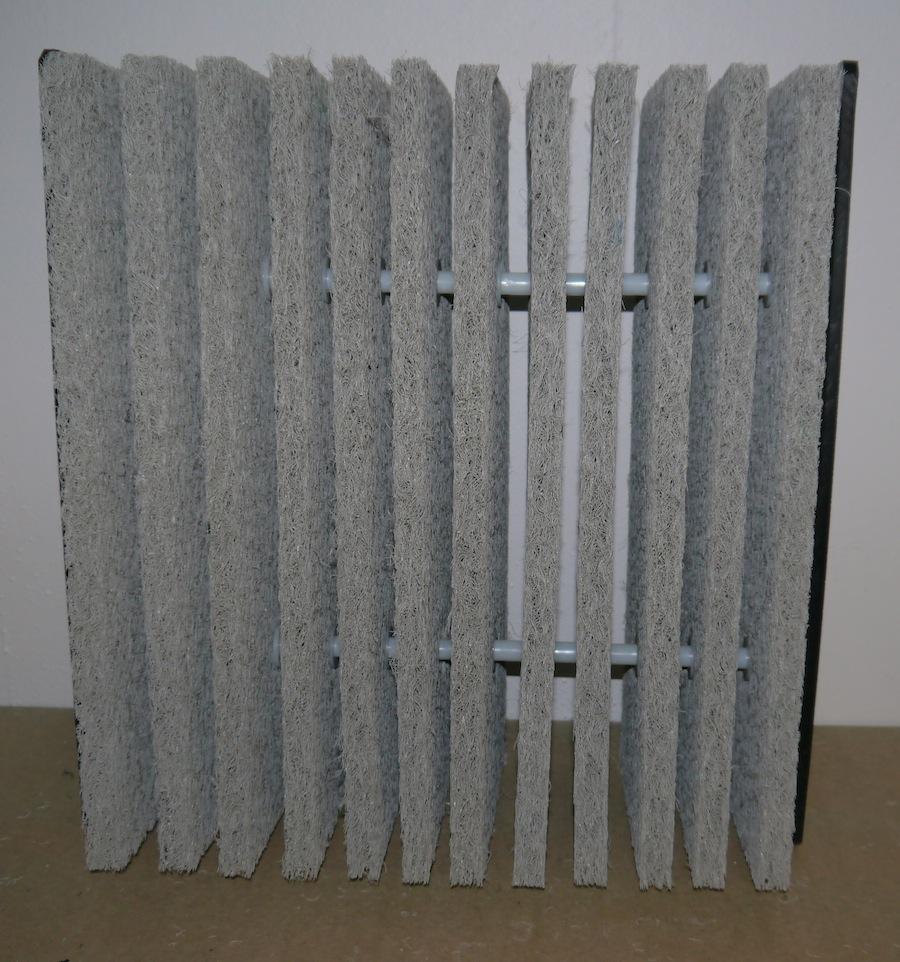 A ERIC Matt Cartridge showing the slots where water can pass through as a block
